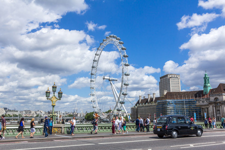 millennium wheel: View of London eye from Westminster Bridge in London, England. Also known as the Millennium Wheel, its official name was originally published as British Airways London Eye. Editorial