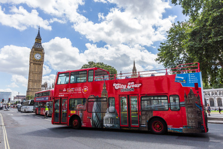 London city tour bus passing Parliament Square. This is one of the best ways to enjoy most of London in a short time. Editorial