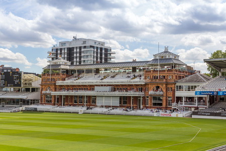 cricket game: Old pavilion of Lords Cricket Ground in London, England. It is referred to as the home of cricket and is home to the worlds oldest cricket museum.