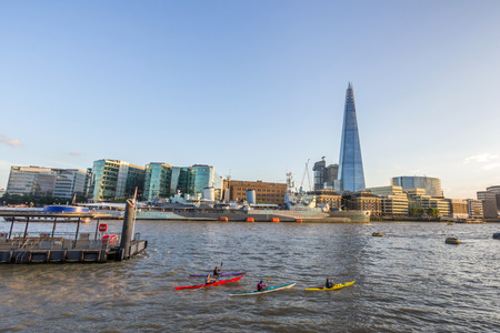 Kayaking in the Thames River next the the Shard in London, UK