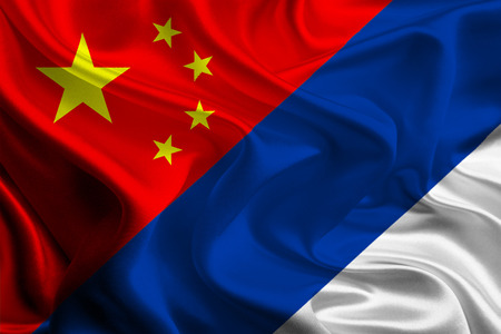 joining together: Chinese and Russian Flags joining together concept Stock Photo