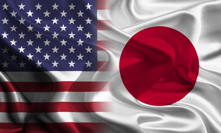 joining together: USA - Japan Flags joining together concept Stock Photo