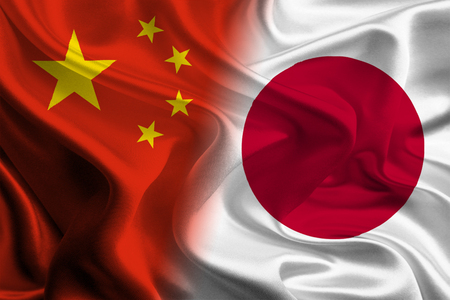 asian business meeting: Chinese and Japanese Flags joining together concept Stock Photo