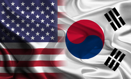 joining together: USA - South Korean Flags joining together concept