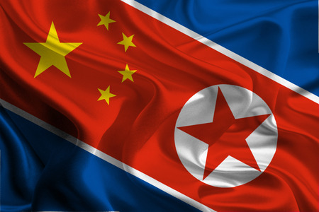 joining: Chinese and North Korean Flags joining together concept