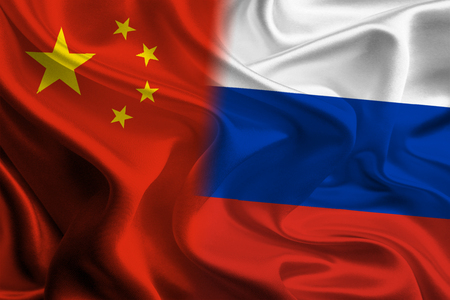coporate: Chinese and Russian Flags waving together concept Stock Photo