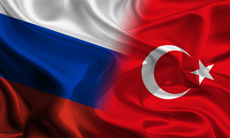 jointly: Russian and Turkish flags joining together concept Stock Photo