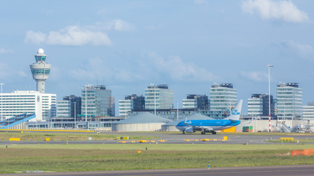 AMSTERDAM, NETHERLANDS - JULY 30, 2015: KLM Airlines flight at Amsterdam Schiphol Airport. It is the main international airport of the Netherlands, located 4.9 nautical miles southwest of Amsterdam. Editorial