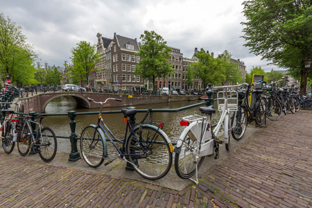 amsterdam: Bicycles lining a bridge over the canals of Amsterdam, Netherlands. Cycling is one of the best ways to get around the city.