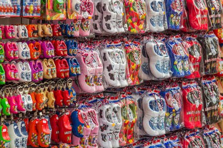 souvenir traditional: Clogs for sale at a Dutch retail shop. Wooden shoes are a well know traditional souvenir from Holland Editorial