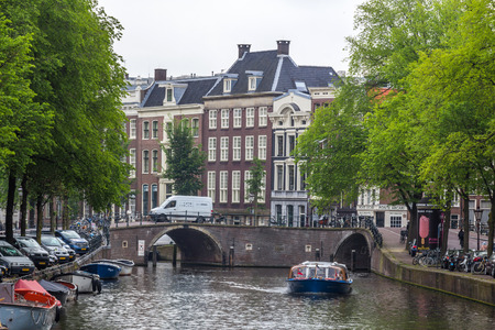populous: Canals through the residential areas of Amsterdam. Amsterdam is the capital and most populous city of the Netherlands.