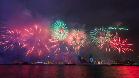 victoria harbor: Spectacular Fireworks over Victoria Harbor in Hong Kong Stock Photo