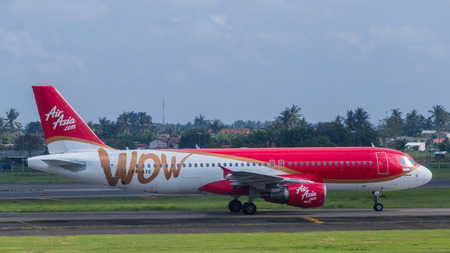 airborne vehicle: AirAsia plane on a runway of Soekarno-Hatta International Airport in Jakarta, Indonesia.