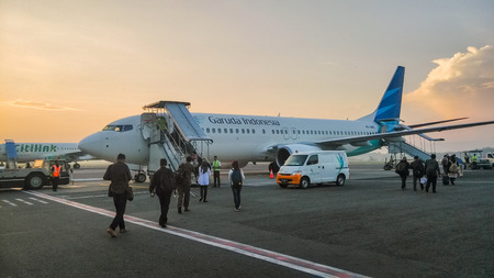A Garuda Indonesia Airplane at sunrise in Adisucipto International Airport in Yogyakarta, Indonesia.