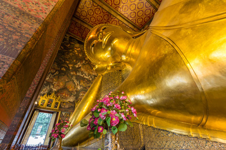 Reclining Buddha of Wat Po. Wat Po is a Buddhist temple complex in the Phra Nakhon District, Bangkok, Thailand. Editorial