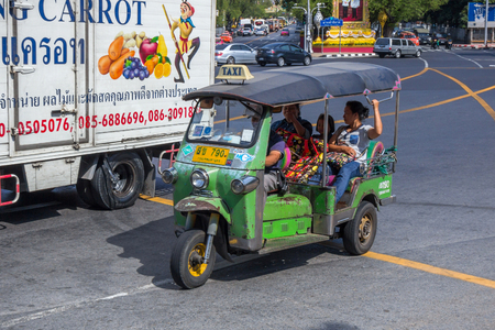 three wheeler: Tuk-tuk taxis on the street in Bangkok. In Bangkok, there are more than 100,000 tuk-tuk.