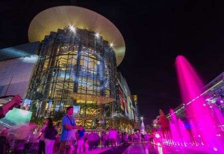 Siam Paragon mall at night in Siam Square mall in Bangkok, Thailand. With 300,000 sq.m. of retail space Siam Paragon is one of the largest malls in the world. Stock Photo