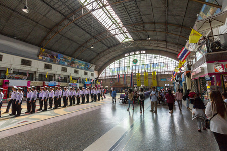 public servants: Officers gathering inside Hua Lamphong railway station in Bangkok. The station was opened in 1916 and serves 60,000+ rides a day. Editorial