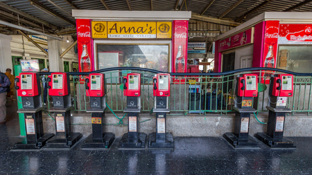 make public: Old and traditional public telephones using the coins to make a call in Bangkok train station, Thailand. Editorial