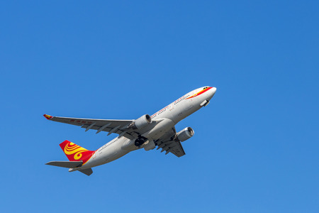 Hong Kong Airlines airplane departing from the Hong Kong International Airport. About 90 airlines operate flights from HKIA to over 150 cities across the globe.
