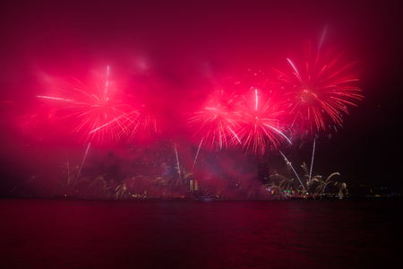 Fireworks show along Victoria harbor in Hong Kong, China.