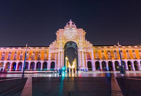 baixa: Rue Augusta arch in Commerce square at night in Lisboa, Portugal. Editorial
