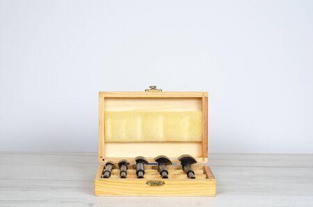 Wooden box with forstner hinge hole boring cutter wood drill bits . Reklamní fotografie