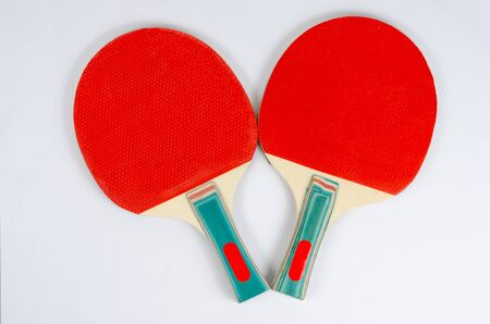 Close up two red ping-pong rackets  isolated on white