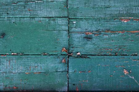 Close-up full frame shot of turquoise old rusty peeling wooden wall as a background Stok Fotoğraf - 132939381