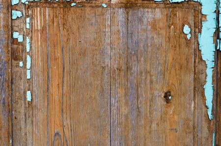 Close up of an old wooden plank  with blue peeling paint