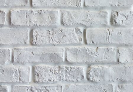 Close up of old degraded brick wall  painted white with vintage look Banque d'images