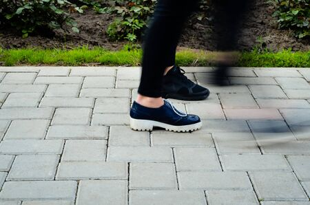 A hurried woman walking on the street - Motion Bluer effect