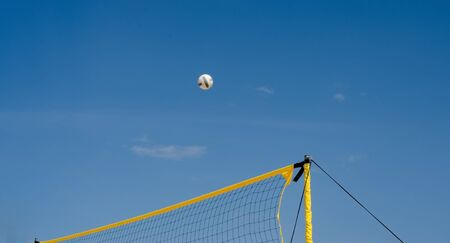 Yellow   net filet beach volley ball  against blue sky .  Relaxing activities on vacation at the sea . Banco de Imagens