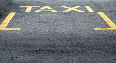 High angle view of yellow taxi sign  on road. Banque d'images - 133006034