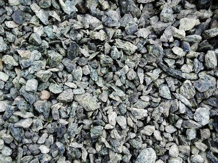 Heap of cracked grey   stones used to decorate the garden or parts of the house Banque d'images - 133061365