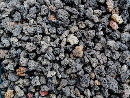 Pile  of natural  porous volcanic rock    stones used to decorate the garden or parts of the house indoor or outdoor Banque d'images - 133061413