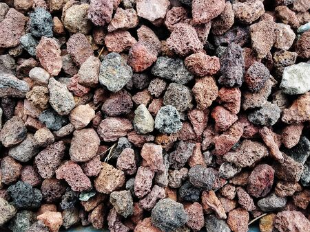 Pile  of natural  brownish porous volcanic rock    stones used to decorate the garden or parts of the house indoor or outdoor Banque d'images - 133061942