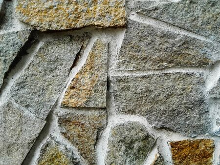 Close-up  of handmade  cracked multicolored  stone and concrete  wall Banque d'images - 133061085