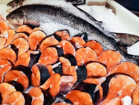 Whole salmon  and    pieces for  sale at the fish shop