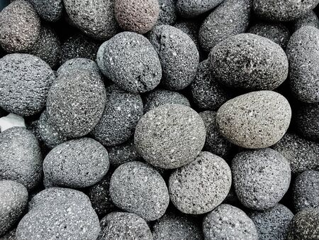 Round gray stones used to decorate the garden or parts of the house Banque d'images - 133061292