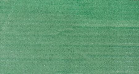 Green paper background. Grain texture art paper in a high resolution. Art background. Stock Photo