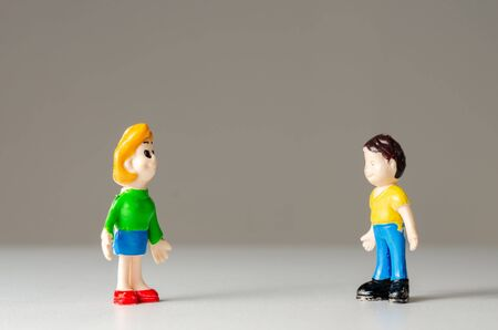 Toys figurines man and woman talking from a distance for fear of coronavirus contamination. Prevention of disease transmission .Romantic date . 스톡 콘텐츠