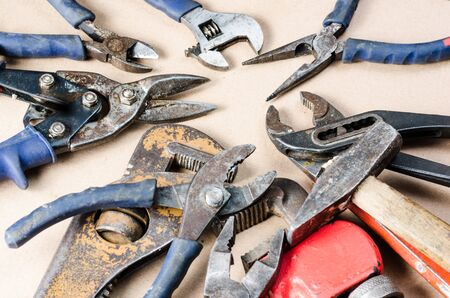 Pile of old tools for construction and repair of plumbing .