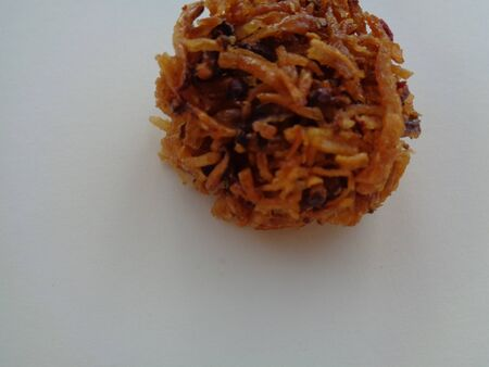 Close up view of jajanan snack food cake kue Carang Mas Emas or Sarang Balam Semut or golden nest or kuih kueh jala. A traditional Sweet asian local dessert. Made from grated length sweet potato fried