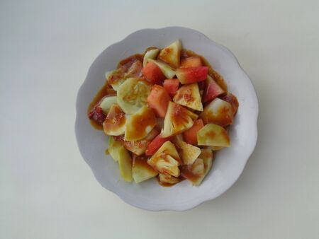 lotis buah or rujak (sweat, sour, spicy and fresh). fruit with hot chili paste. indonesian traditional fruit salad