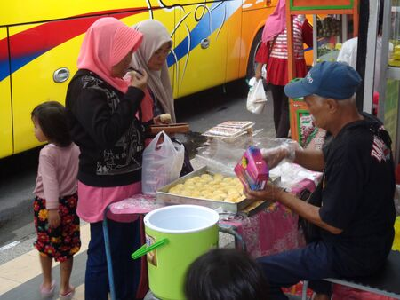 Kediri, Indonesia - 03 January 2020 : Bakpia sellers are serving buyers. Bakpia Is Traditional Foodcakebakery From Yogya Indonesia
