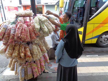 Kediri, Indonesia - 02 January 2020 : Krupuk seller in the street. Located near Pusat Oleh-Oleh Shinta Editorial