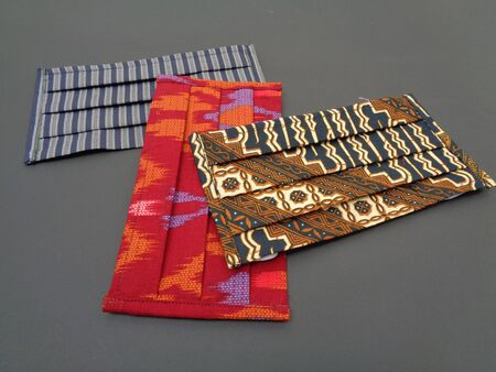 Fabric face mask with batik (ethnic) motif and pattern from Indonesia is very stylish and it can protect from air polution. Stylish Handmade masker to protect from corona virus or Covid 19.