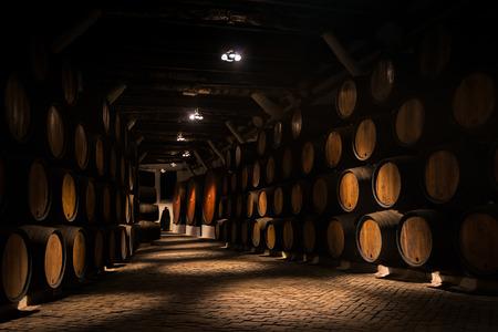 dring: Barrels of Porto vine in a cellarin Porto, Portugal