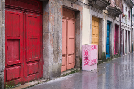 unoccupied: Bright colorfull doors at the tourist street in Porto, Portugal. Stock Photo